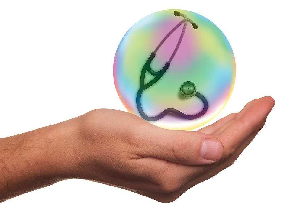 hand holding stethoscope